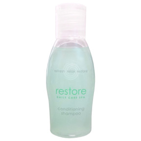 Dial® Restore Daily Care Spa Conditioning Shampoo C03-0114001-8100-1 fl. oz. travel size bottle of conditioning shampoo.