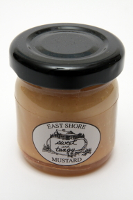 East Shore Mustard - Sweet & Tangy F01-0268701-3100 - 1.4 oz glass jar sweet and tangy mustard. A convenient travel size for on the go.