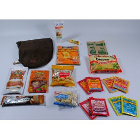 Autumn Komfy Kit K01-1159911-1200 - 14 different travel size products (18 total) in a vinyl bag with orange tissue paper